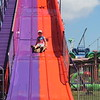 Cameron Rauch, 5, Painesville Township goes down the super slide at the 2018 Lake County Fair on July 25.<br /> Kristi Garabrandt - The News-Herald