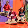 Bret Simons, 11, Cleveland, Sufferann Ransom, 13, and Elenor Ransom, 10, both of Madison go down the super slide at the 2018 Lake County Fair on July 25.<br /> Kristi Garabrandt - The News-Herald