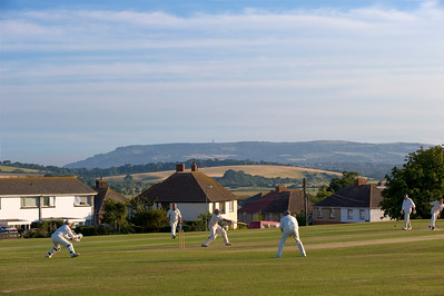 Playing cricket on village green, St Helens, Isle of Wight, United Kingdom