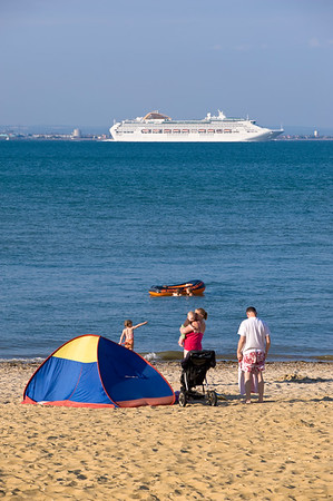 People enjoy hot summer day on beach in Appley Park overlooking English Channel, Ryde, Isle of Wight, United Kingdom
