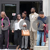 Sam Buckner for Shaw Media.<br /> Corey Butler walks out of the courthouse with his family on Tuesday July 26, 2017.