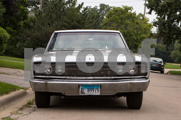 Sam Buckner for Shaw Media.<br /> Brett Littlefield's 1966 Dodge Charger sits outside his house on Wednesday July 26, 2017.