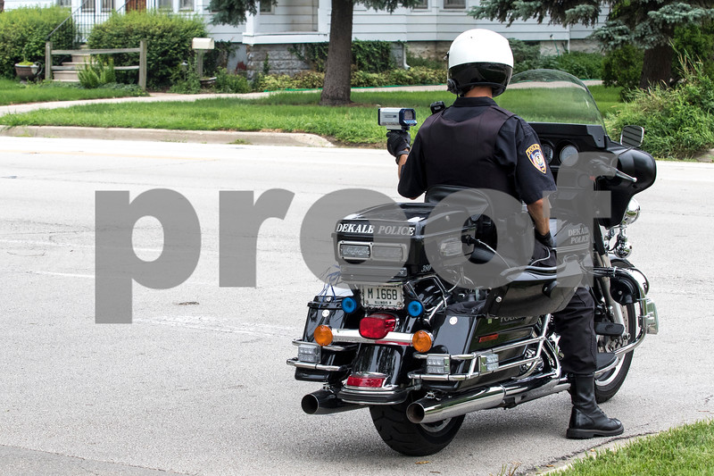 Sam Buckner for Shaw Media.<br /> Officer Jared Burke uses a radar gun to try and fine speeders on Wednesday July 26, 2017. Wednesday was speed awareness day in Illinois.
