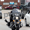 Sam Buckner for Shaw Media.<br /> Officer Jared Burke rides a motorcycle on Illinois speed awareness day Wednesday July 26, 2017.