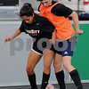 Jessica Gamez and Derek O'Brien of DeKalb battle for the ball in a scrimmage game at the DKCU Street Soccer Tournament on Friday in Sycamore.  Steve Bittinger - For Shaw Media