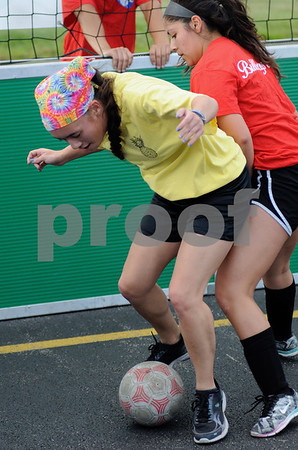 Kate Umekubo of Sycamore moves the ball for the Pavement Pineapples in the DKCU Street Soccer Tournament on Friday in Sycamore.  Steve Bittinger - For Shaw Media