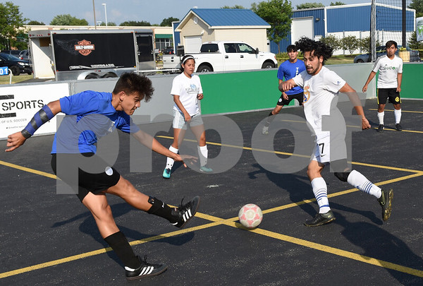 Players from the Rochelle Cougars and Flint Tropics battle in the DKCU Street Soccer Tournament on Friday in Sycamore.  Steve Bittinger - For Shaw Media