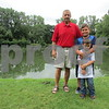 Charles Ridulph stands Thursday at Walcamp Outdoor Ministries and Retreat Center with this year's recipients of the Maria Ridulph Memorial Fund, including brothers Guicho Martinez, 10, and Eli Martinez, 6. The fund was established to honor Ridulph's late sister, Maria Ridulph, who was kidnapped and killed at age 7 in 1957.