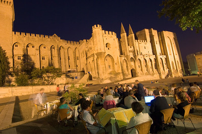 Europe, France, Provence, Avignon, dining alfresco at night by Palais des Papes