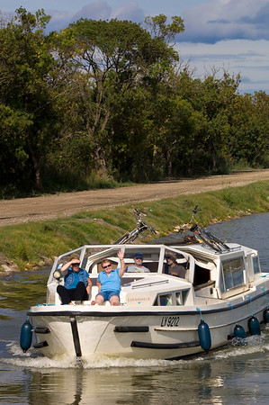 Europe, France, Provence, Camargue, cruising along the canal in Petite Camargue near Aigues-Mortes, Canal du Rhone A Sete