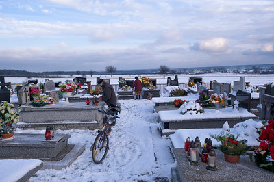 Cemetery and winter landscape covered in snow, Jasieniec, Poland
