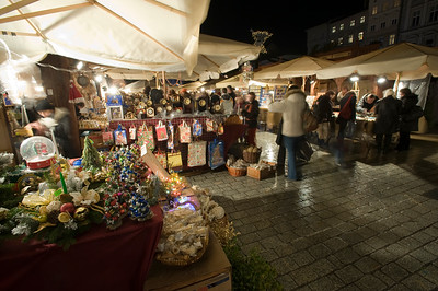 People shopping at Christmas Market at night, Main Square, Cracow, Poland