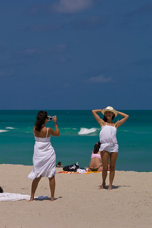 Two young girls a relaxing on a beach, South Beach, Miami, USA
