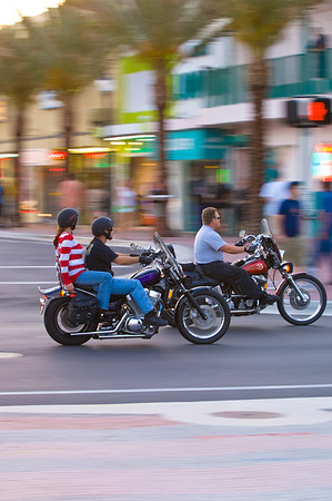 Bikers cruising in late afternoon on Fort Lauderdale Beach Boulevard, Fort Lauderdale, Gold Coast, Florida, United States of America