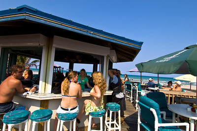 Young people enjoying  a drink in a bar, beach, Cocoa Beach, Gold Coast, Florida, United States of America