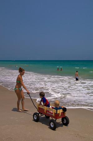 People rrelaxing on a beach, Melbourne Beach, Gold Coast, Florida, United States of America