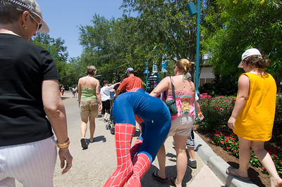 Visitors with a Spiderman trophy, Seaworld theme park, Orlando, Florida, United States of America