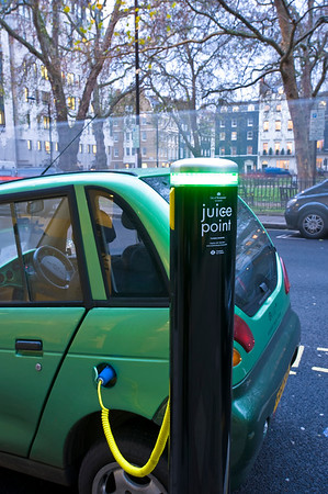 G Wiz electric car is being charged up from a City of Westminster  Juice Point, London, United Kingdom