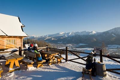 Skiers relax in lokal bar on Gubalowka Hill overlooking Zakopane and Tatra Mountains, Podhale Region, Poland