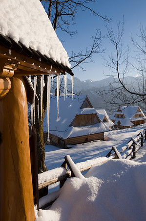 Icicles on wooden gate and typical architecture of Zakopane, Tatra Mountains, Podhale Region, Poland