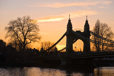 Hammersmith Bridge over Thames River at dusk, Hammersmith, W6, London, United Kingdom