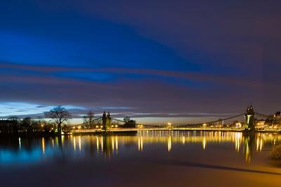 Hammersmith Bridge over Thames River at dusk, Hammersmith, W6, London, United Kingdom