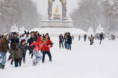 School children are having snowball fight in Kensington Gardens covered in February snow, SW7, London, United Kingdom