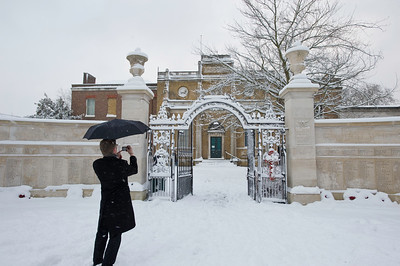 Man is photographing Pitzahanger Manor in Walpole Park covered in February snow, Ealing, W5, London, United Kingdom