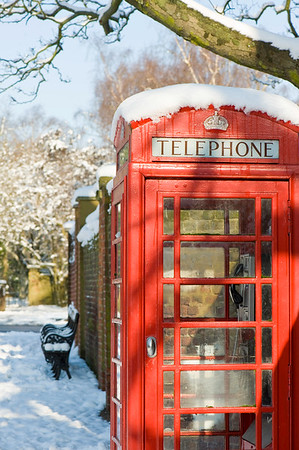 Traditional red telephone box covered in snow, Hampstead, NW3, London, United Kingdom