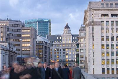 Commuters walking over London Bridge, London, United Kingdom