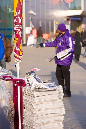 Free newspaper is distributed on sidewalk, London, United Kingdom