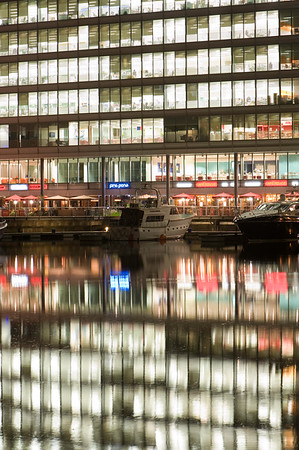 Offices illuminated at night in St Katharine Docks, London, United Kingdom