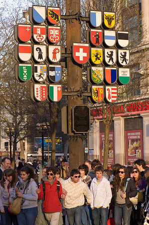 Tourists in Leicester Square, West End, London, United Kingdom