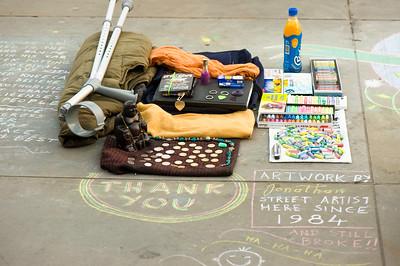 Street artist drawing on pavement, London, United Kingdom