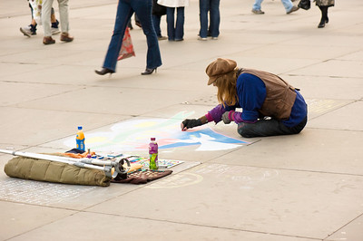 Street artist drawing on pavement, London, United Kingdom