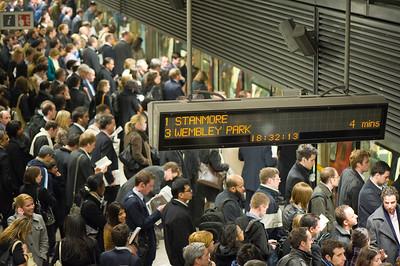 Commuters on crowded platform awaiting train, Canary Wharf, Docklands, London, United Kingdom
