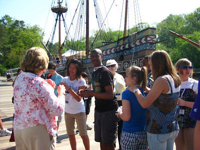 "Learning about the ships of the day. Replica of the ""Susan Constant"" in the background."