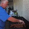 Kristi Garabrandt - The News-Herald<br /> Eastlake Councilman Ken Hoeffle cooks hots dogs during Eastlake's National Night Out.