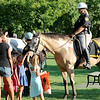 Jonathan Tressler - The News-Herald. A mounted Geauga County deputy and her horse get plenty of attention during Chardon's National Night Out event, which included participants fro a number of Geauga and Lake County public safety agencies.