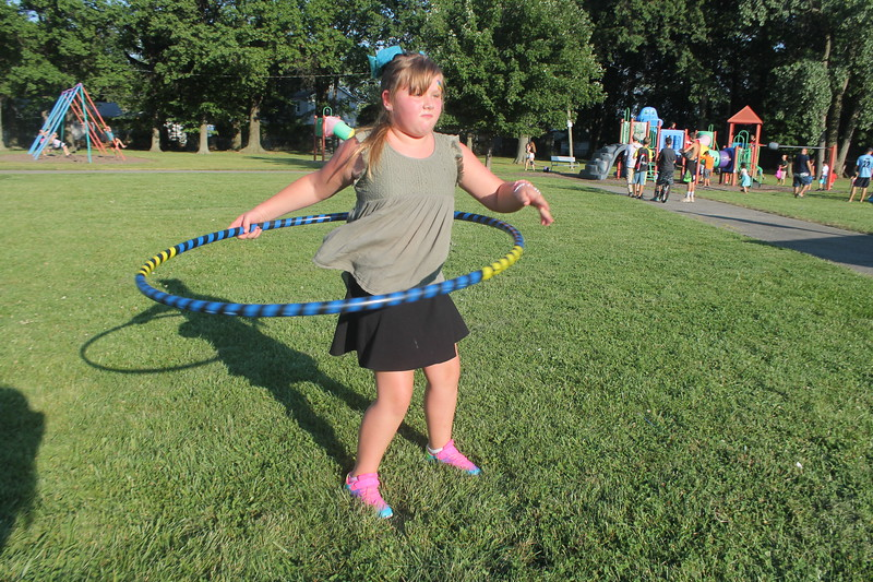Kristi Garabrandt - The News-Herald<br /> Chloe Conway, 8, Eastlake shows off her skills with a hula hoop during Eastlake's National Night Out.