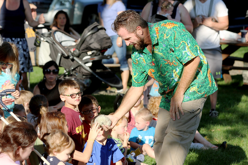 Jonathan Tressler - The News-Herald. children take turns touching a hedge hog during an exotic animal demonstration Aug. 1 during Chardon's National Night Out observance.