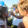 Kristi Garabrandt - The News-Herald<br /> Leonarda Miletic does face painting on Isabella Thomas, 8, Eastlake during Eastlake's National Night Out.
