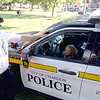 Jonathan Tressler - The News-Herald. It's tough to tell who's having more fun in this picture taken Aug. 1 at Chardon's National Night Out event - 5-year-old Samantha Poling in the driver's seat of a police SUV, or Chardon Police Chief Scott Niehus.