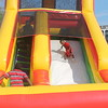 Kristi Garabrandt - The News-Herald<br /> Tommy Moore, 4, Euclid slides down a bounce house slide, one of the main attractions at Euclid's National Night Out.
