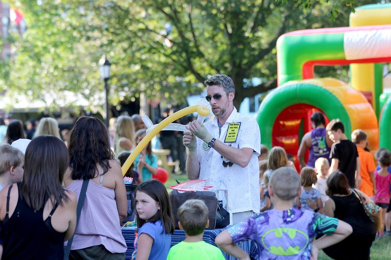 Jonathan Tressler - The News-Herald. THe lines for balloon sculptures and for the bounce house were dozens deep Aug. 1 on Chardon Square for the community's National Night Out observance.
