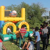 Kristi Garabrandt - The News-Herald<br /> Kids race through the bounce house at Euclid's National Night Out.