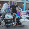Kristi Garabrandt - The News-Herald<br /> Aubrey Stand, 6, Eastlake checks out a police motorcycle with help from Eastlake officer Cole Eden, during Eastlake's National Night Out.