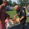 Kristi Garabrandt - The News-Herald<br /> Euclid police officer L. Longstreth helps Jaylah Davis, 5, Euclid pick out a bracelet during Euclid's National Night Out.