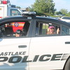 Kristi Garabrandt - The News-Herald<br /> Logan Lait, 10, Eastlake, sits in the front of an Eastlake police car while his sister Abby, 8 sits in the back during Eastlake's  National Night Out.