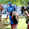 Jonathan Tressler - The News-Herald. Actors from Cleveland-based Spectacular Party Entertainment, Inc., portraying Capt. America, Batman and Wonder Woman interact with some visitors to Chardon's National Night Out observance Aug. 1.